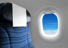 Blue seat beside window plane. Sky view stock image
