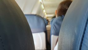 Blue seats in airplane, uncomfortable flight, low cost company, economy class stock video