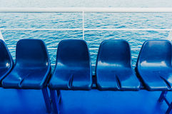 Blue seats on a ferry Royalty Free Stock Images