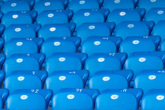 Blue seats on football stadium Royalty Free Stock Photos