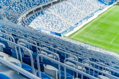 Blue seats with handrails on the tribune of the stadium. Blue seats with handrails on the tribune of the stadium stock photography