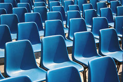 Blue seats in a row Royalty Free Stock Photos
