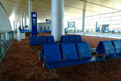 Kunming airport. Blue seats row in the waiting hall of most famous airport in china, named changshui airport.it`s one of the most biggest airports in the world stock image
