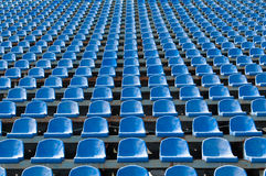 Blue seats for spectators in the stadium. Seats for spectators in the stadium located in the geometric pattern Stock Photography