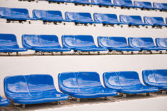 Blue seats for sports fanclub on the stadium Royalty Free Stock Photography