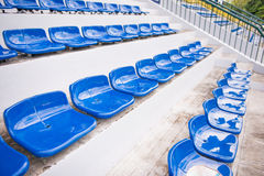 Blue seats for sports fanclub on the stadium Royalty Free Stock Images