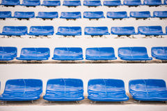 Blue seats for sports fanclub on the stadium Stock Images