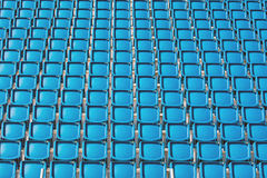 Blue seats of a stadium Stock Photography
