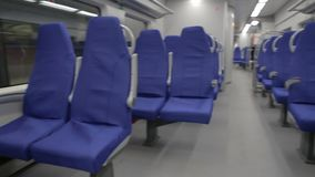 Blue Seats in a Suburban Train. Seats in a suburban train in the European region.Steady Shoot internal of a Regional Passenger Empty Train with Blue Seats stock video