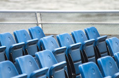 Blue seats. On Thames ferry, London UK Stock Image