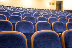 Blue seats in a theater. Concert event Royalty Free Stock Photography