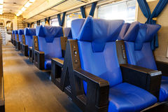 Blue seats in train Royalty Free Stock Images
