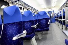 Blue seats in the train Stock Photography