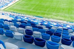 Blue seats on the tribune of the stadium. Royalty Free Stock Photography