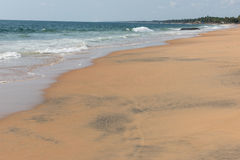 Blue Seawater on Beach. View of the sea water coming down the shoreline of Kovalam sandy beach in Thiruvananthapuram. Kovalam is famous for its golden sandy royalty free stock photo