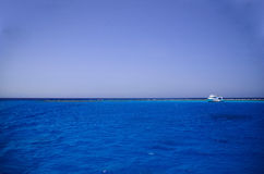 Blue seawater and ship at coral reef Stock Image
