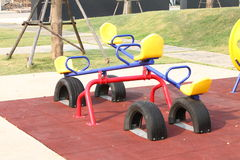 Blue seesaw and yellow seat for the kid Stock Images