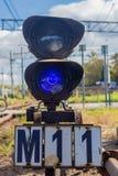 Blue semaphore near railroad stock photography