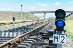 Blue semaphore on railroad Stock Photo
