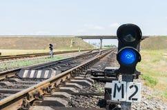 Blue semaphore on railroad Stock Image