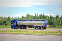 Blue Semi Tank Truck on Freeway at Summer Stock Photography