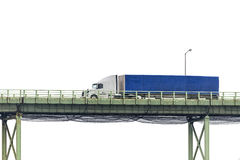 Blue Semi Truck Crossing Bridge Isolated on White Royalty Free Stock Photos