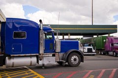Blue semi truck rig on truck stop side view Royalty Free Stock Images