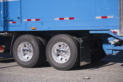 Blue semi truck trailer with axles and wheels Royalty Free Stock Photography