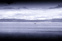 Blue sepia boat in Norway sea landscape background Stock Image