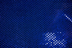 Blue sequined sparkling cloth background Stock Image
