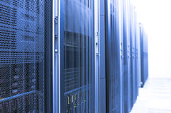 Blue Server Room. A server room with a blue filter fading into a white background Stock Photography