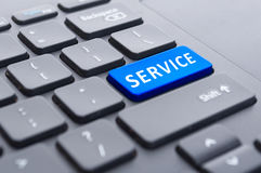 Blue service button on black keyboard concept Stock Image