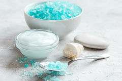 Blue set for bath with salt and shells on stone table background Royalty Free Stock Photography