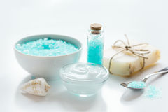 Blue set for bath with salt and shells on white table background Royalty Free Stock Photo