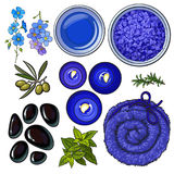 Blue set of spa salon accessories - basalt stones, massage oil, towel, candles, aromatic salt Royalty Free Stock Image