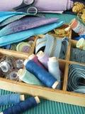 Blue sewing utensils stock image