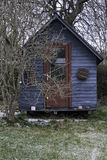 Blue Shack in the Garden Royalty Free Stock Photo
