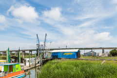 Blue Shack by Shrimp Boats Royalty Free Stock Photo