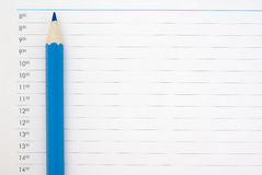 Blue sharp pencil. On the page of the schedule Royalty Free Stock Photo