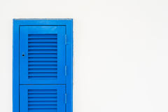 Blue shatter window on white wall Stock Photo