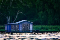 Blue shed on dock  Royalty Free Stock Photos