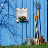 Blue shed with garden tools. Spring in the garden. A garden shed with tools Stock Image