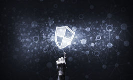 Blue shield icon as symbol of access protection on dark backgrou Stock Photo