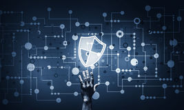 Blue shield icon as symbol of access protection on dark backgrou. Person touching shield glowing icon as concept about security and protection stock photography