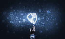 Blue shield icon as symbol of access protection on dark background Stock Photo