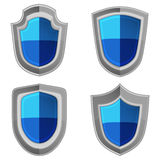 Blue shields set with stripes isolated Royalty Free Stock Photography