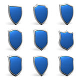 Blue shields on white set Stock Photography