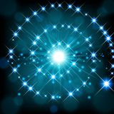 Blue shine with sparkle forming spiral background Stock Photos