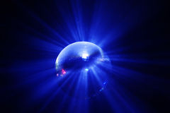 Blue shining disco ball in motion