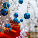 Blue shiny balls on Christmas street in Paris, France Stock Photography